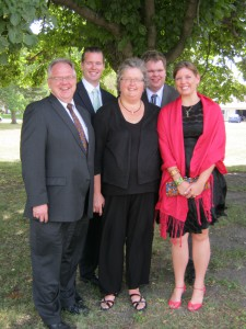 4-H also played a key role in helping the Sukups pursue interests that helped lead to career success.  Pictured from left to right are Charles and Mary Beth with their three children, Jonathan, Andrew and Elizabeth