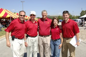 Coach Paul Rhodes (center) with Chris, Bill, Shannon and John Latham