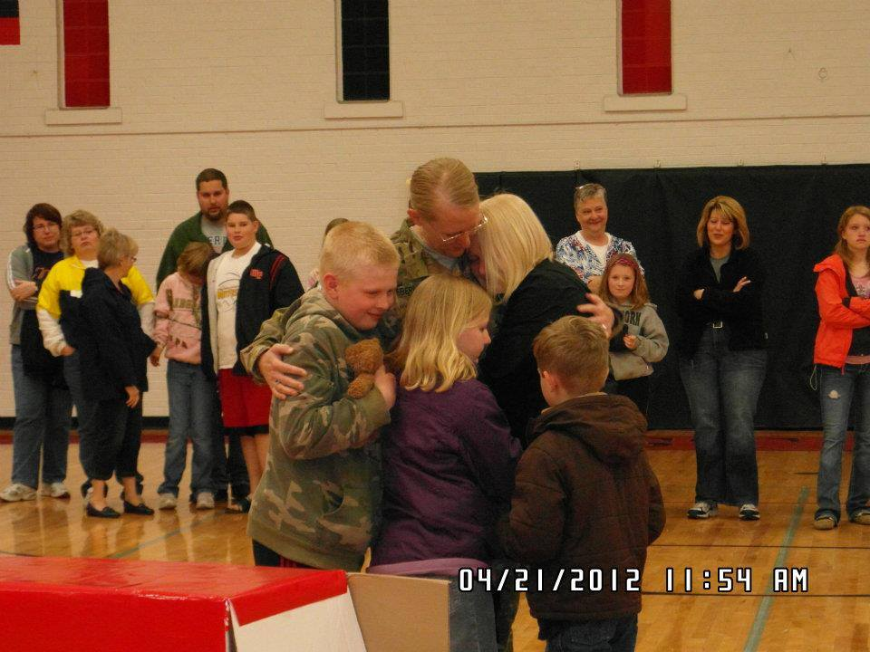 Amy Eberling with her children upon her return from Afghanistan
