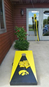 """This morning our office was """"taken over"""" by Hawkeye fans. They hung their flag and set up the bean bag toss. This is just part of the fun and games during Latham Hi-Tech Seeds' annual company tailgate lunch."""