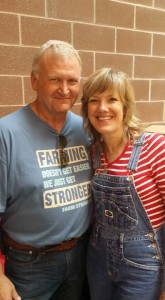 """Larry Sailer visits with his good friend and great advocate Rhonda Ross, who performs the """"Thank a Farmer"""" magic show at the Iowa State Fair"""