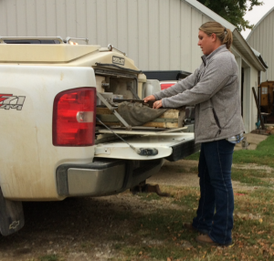 Dr. Katie Lang gets supplies out of her vet truck.