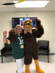 Kerri dressed up as Aaron Rodgers with the Mid-Prairie mascot during on favorite team day during Homecoming Week this year.