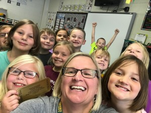 Ms. Bell takes a selfie with her class to celebrate being respectful, responsible & safe in their class.