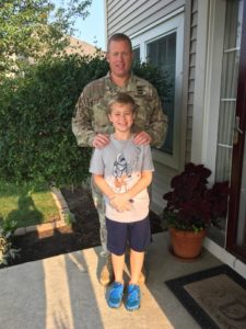 Ethan in camo with son